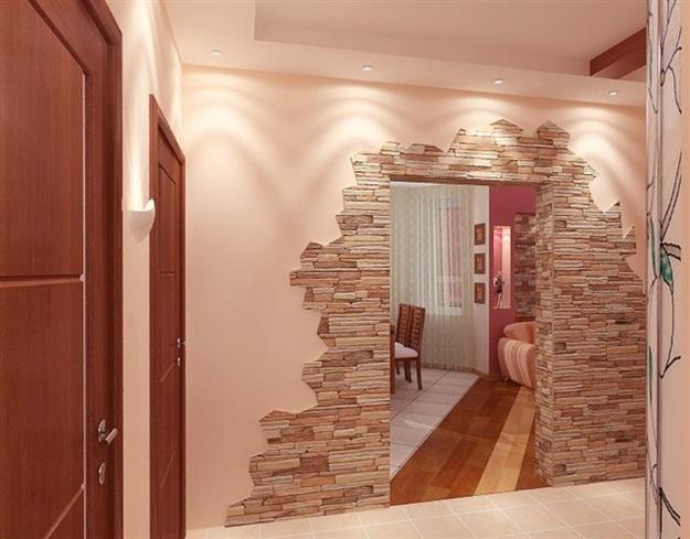 в интерьере комнаты искусственный камень